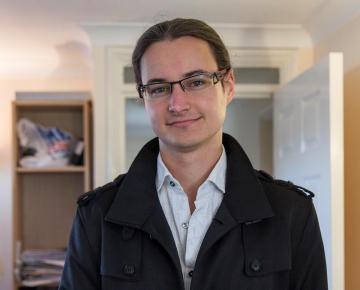 A photograph of Adam C Roberts